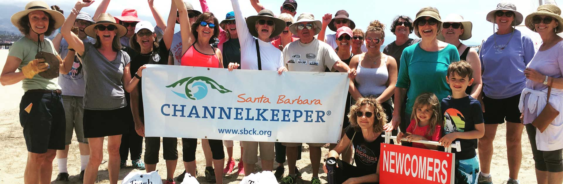 Happy beach cleanup volunteers.