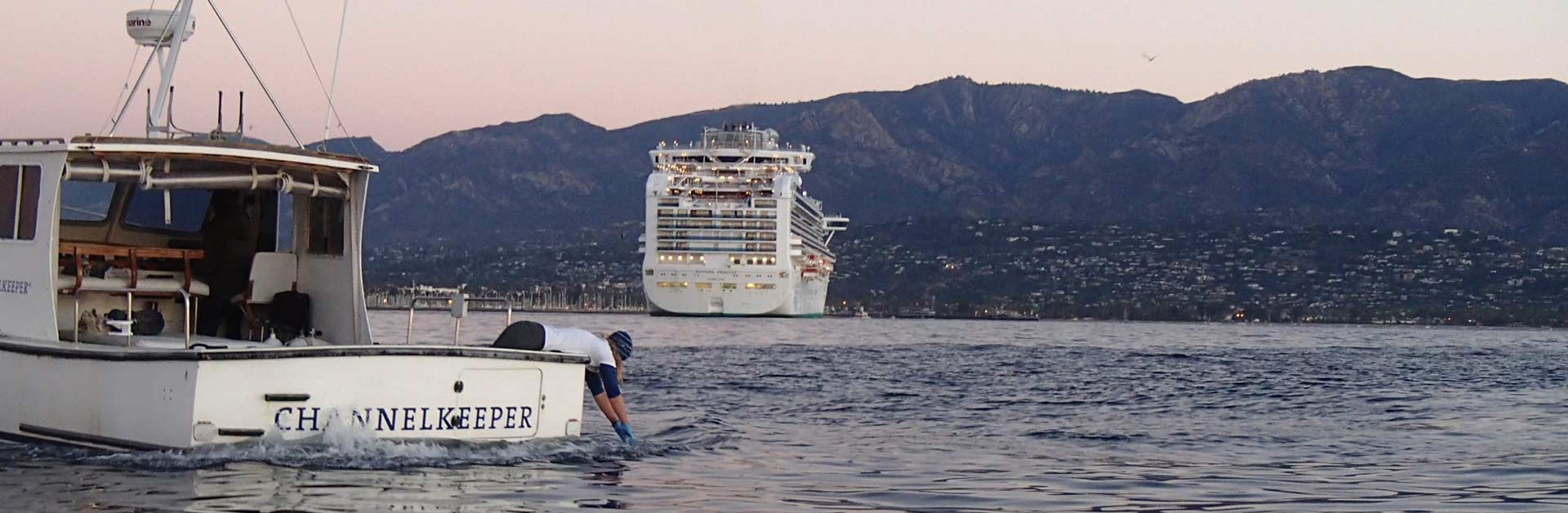 Santa Barbara Channelkeeper's team testing the water for pollution behind a huge cruise ship.